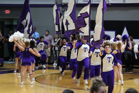 co-ed-cheerleaders-leading-out-the-basketball-players