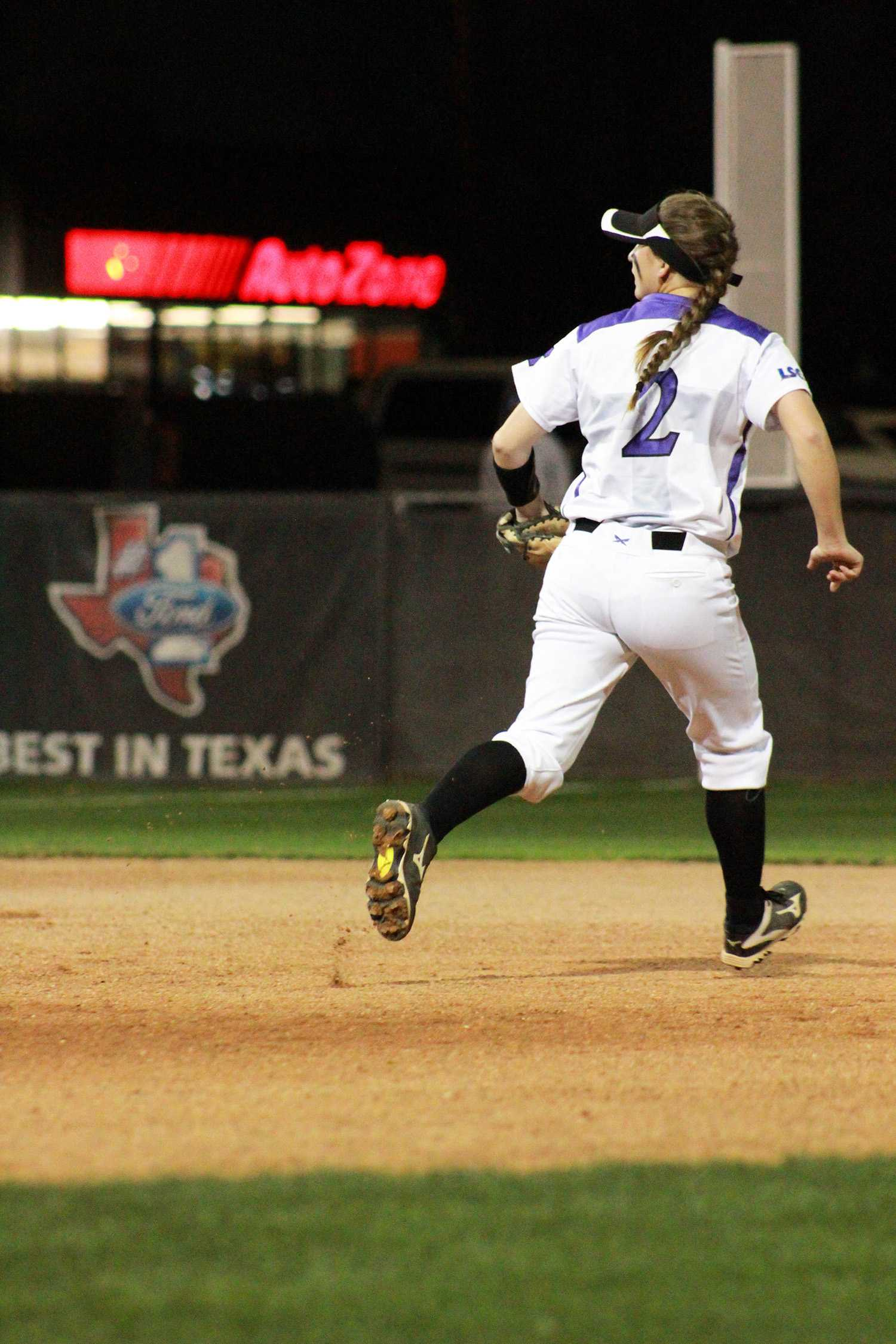 Marisa Flores running to protect second base.