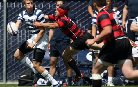 BYU's William Taylor runs with the ball during the Wasatch Cup rugby match against the University of Utah at BYU in Provo on Saturday, April 7, 2012.