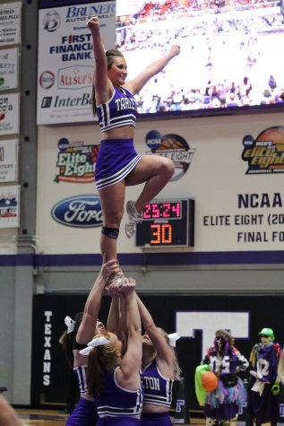 texan-cheer-preforming-a-stunt