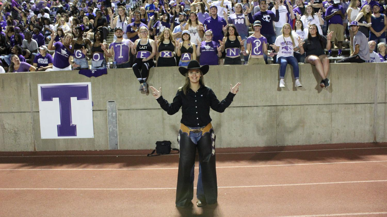 Gambrell, Texan Rider, throws her guns up with PANKUS while helping students to cheer on the Tarleton Texans towards their win last Saturday at Memorial Stadium.