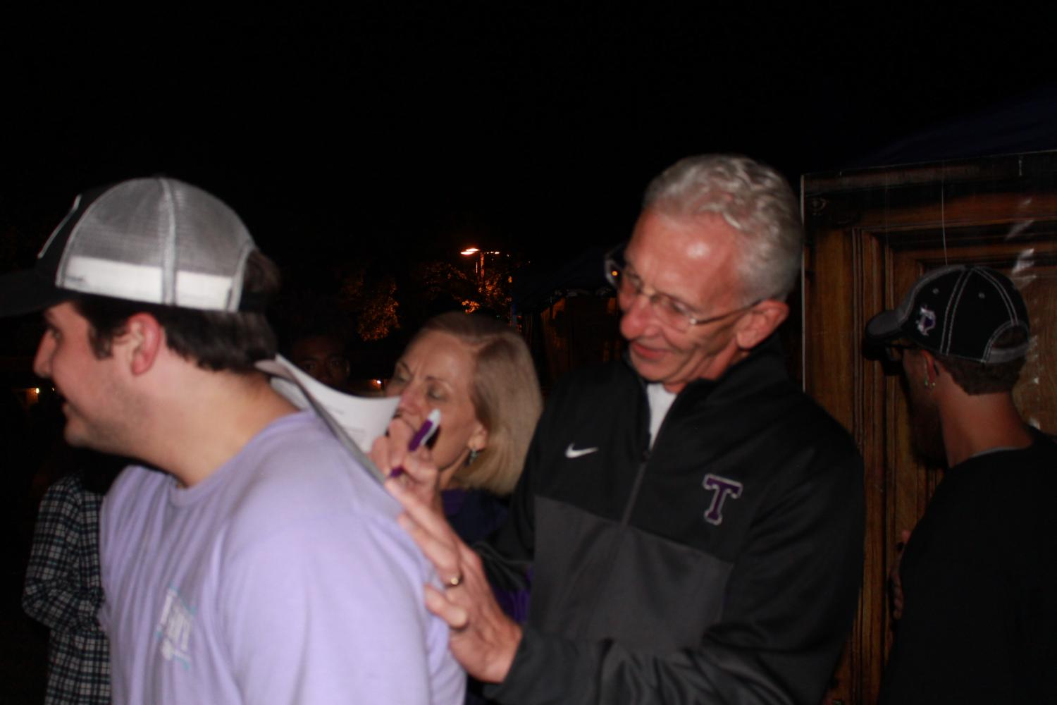 Dr. Dottavio and his wife sign waivers to enter the haunted house.