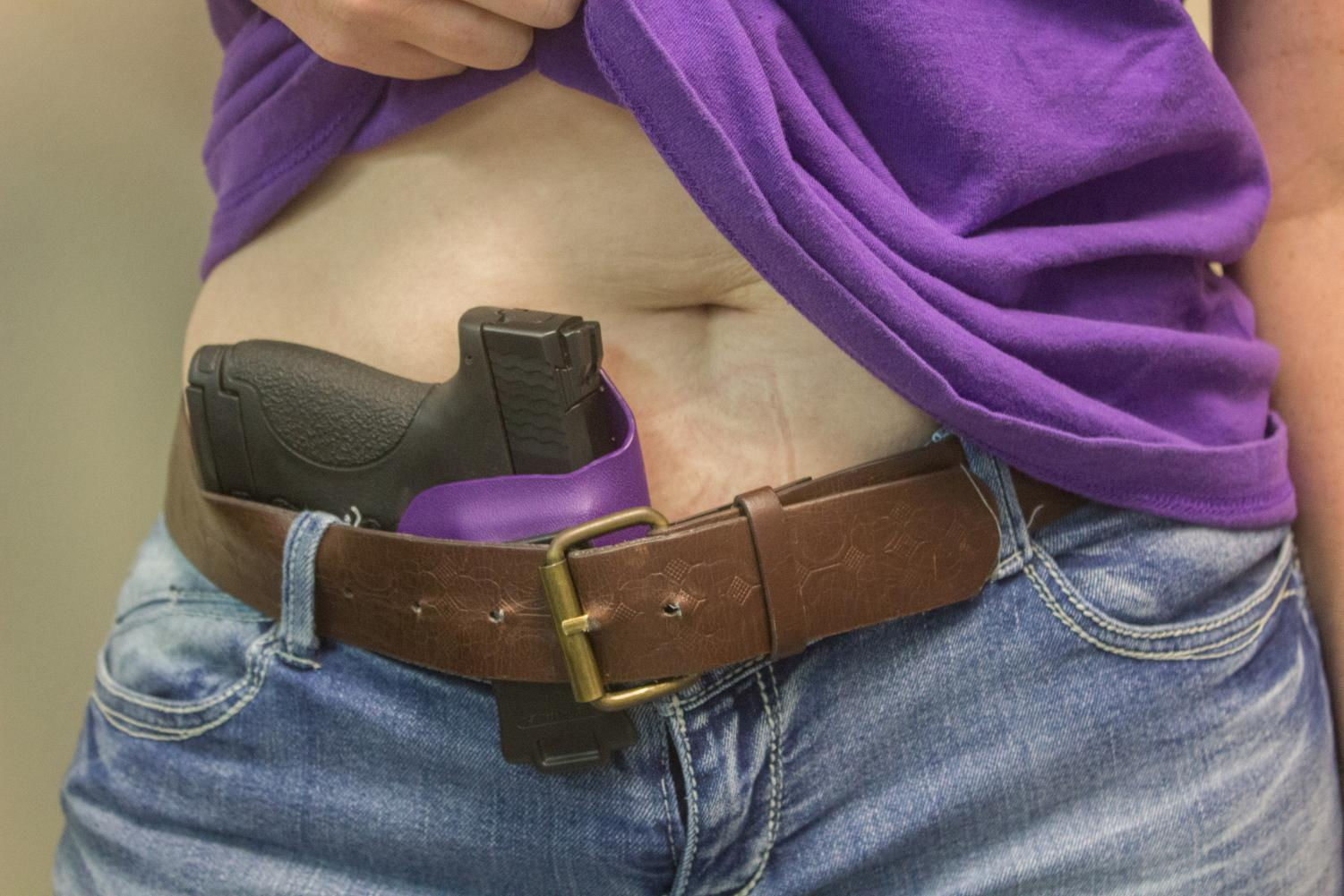 Example of a conceal carry position on an anonymous female model.
