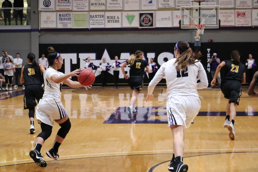 Forward Katie Webster passes the ball to Guard Nina Alvarez.