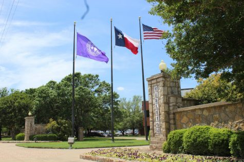 The flags flying in front of the the entrance of Tarleton State University.