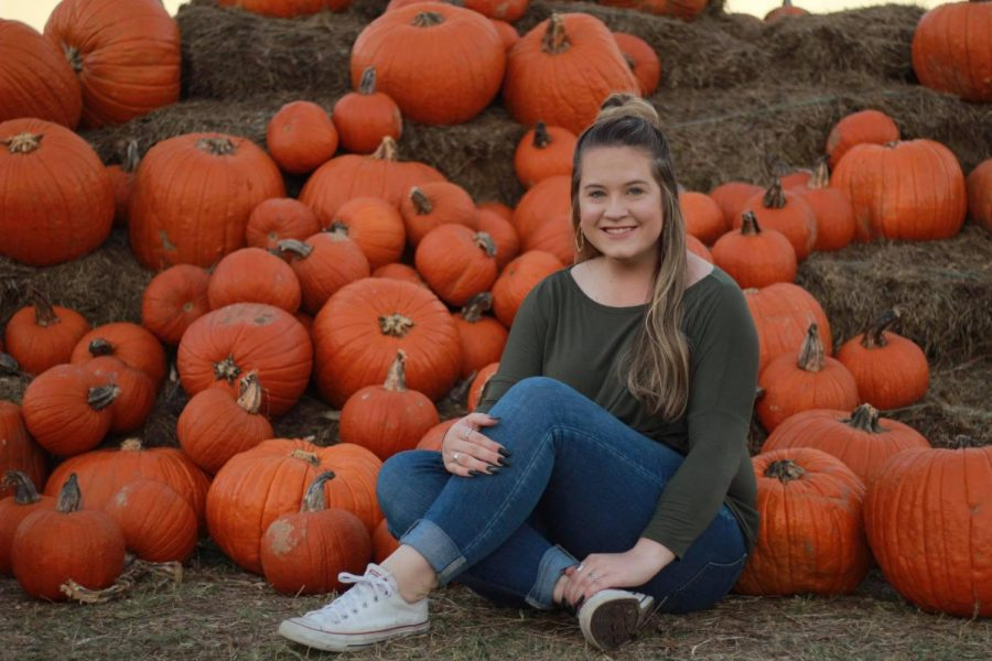 Madison+White+takes+a+photo+with+the+pumpkins+at+Lone+Star+Family+Farm+in+Stephenville%2C+Texas+during+Fall+of+2018.