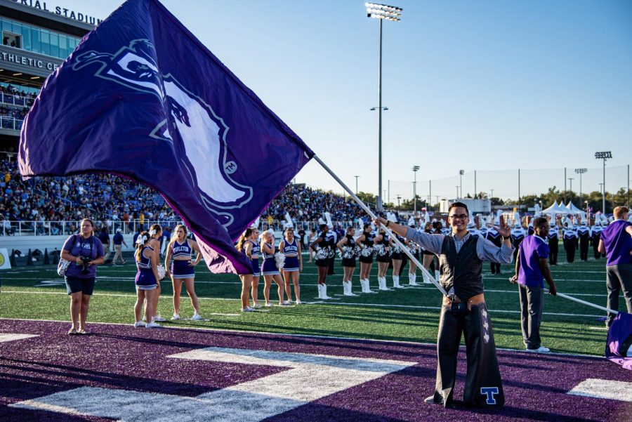 Elijah+Perry+Imbong+holds+the+Tarleton+Flag+before+the+Homecoming+game+on+Saturday+Oct.+19+during+Texan+Tunnel.