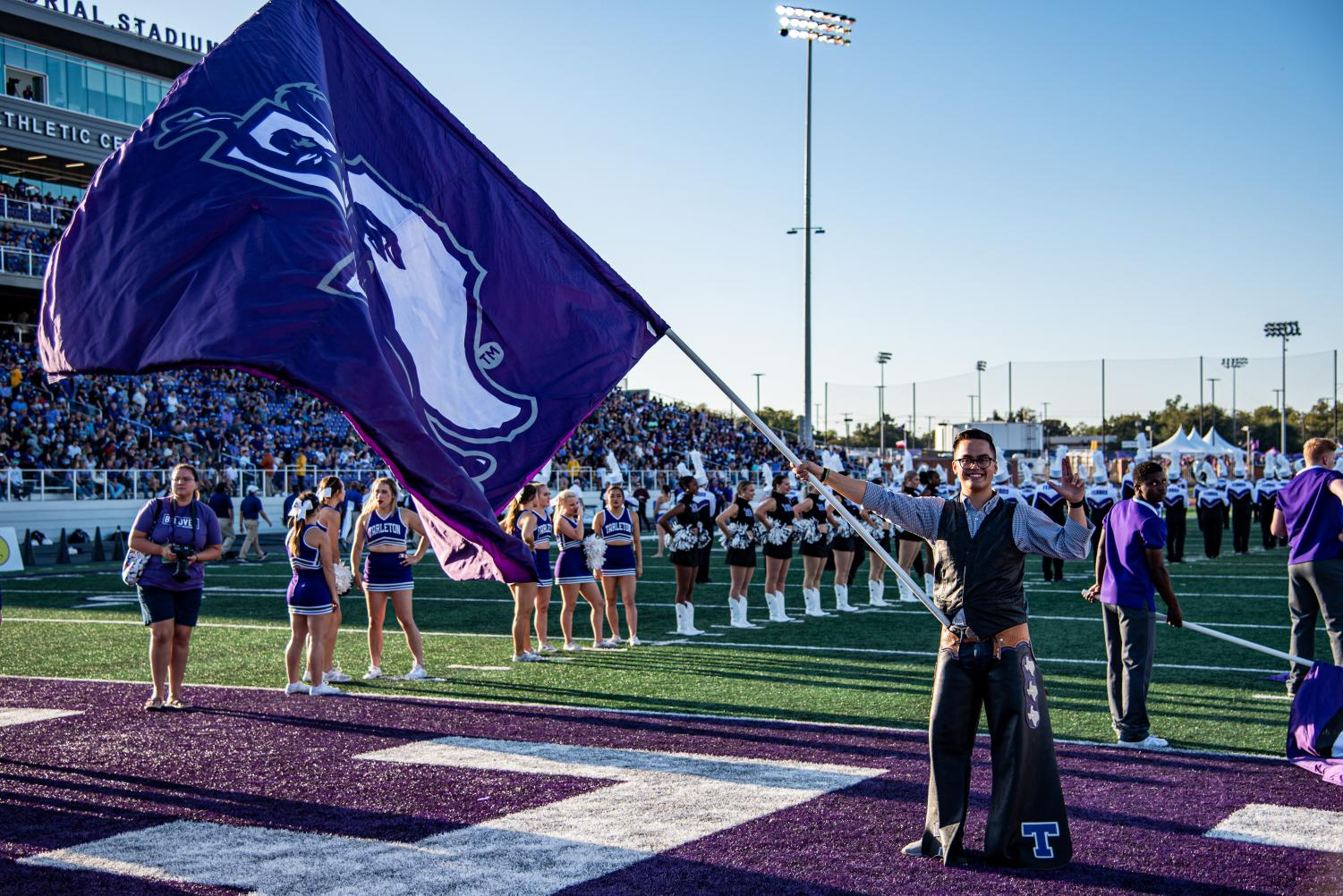 Elijah Perry Imbong holds the Tarleton Flag before the Homecoming game on Saturday Oct. 19 during Texan Tunnel.