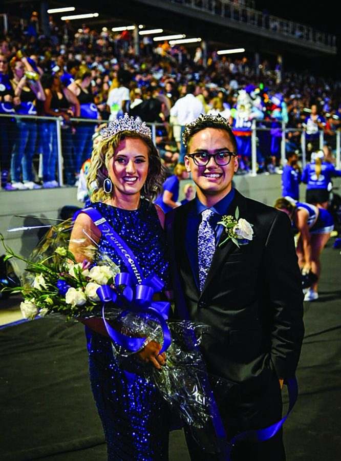 The homecoming King and Queen Elijah Perry Imbong and Lauren Onslott stand together after they are crowned.
