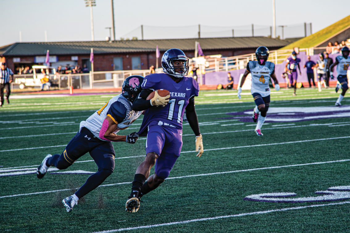 Wide receiver Camron Lewis attempting to out run an A&M Commerce defender in Tarleton's Homecoming game on October 19, 2019.