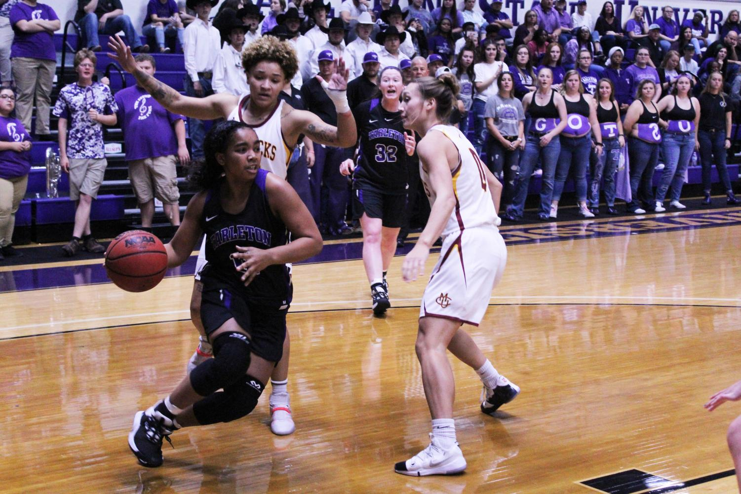 Jasmine Bailey dribbling passed defenders in Tarleton's game against Colorado Mesa on Nov. 9, 2019.