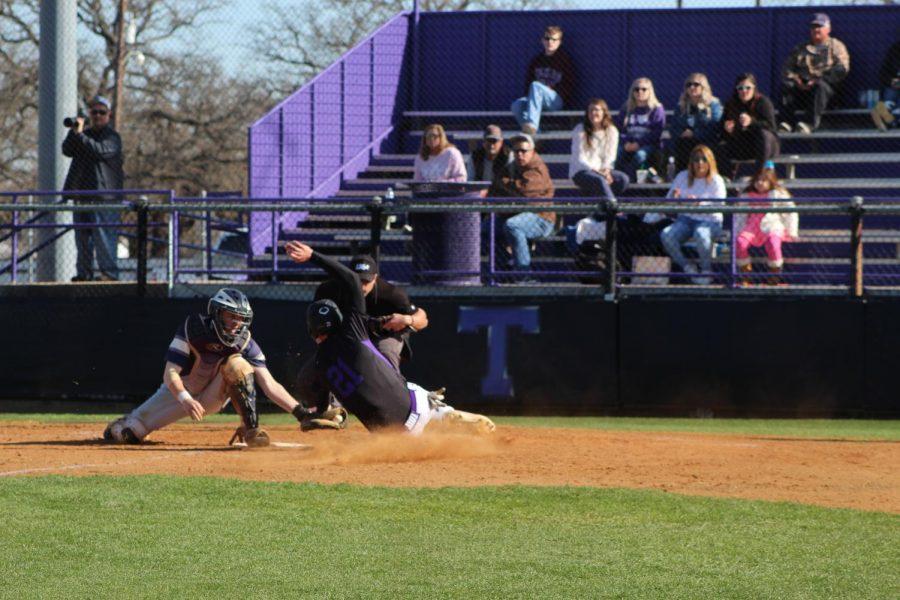 Blake Burns slides into home base in Tarleton's game against University of Arkansas Fort Smith on Feb. 14, 2020.