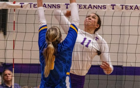 Lauren Kersey jumping to spike the volleyball against St. Mary's during Parent Weekend's match up on September 21, 2019.