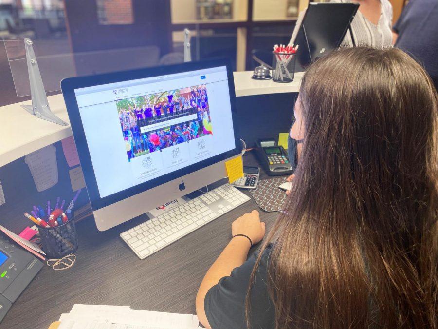 Junior, Kylan Mills, looks up different organizations on TexanSync.