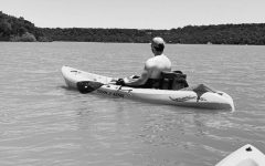 Alyssa Searcy and Travis Moore kayak on Lake Mineral Wells.