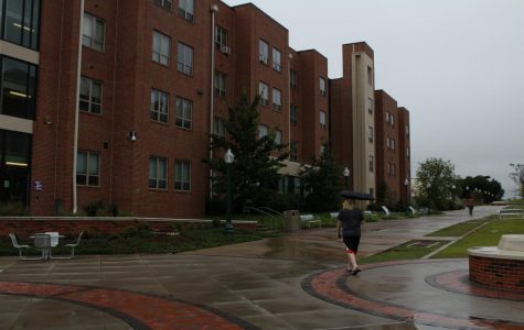 A student walks past Honors Hall while trying to stay dry during the rain we experienced Sept. 1.
