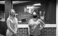 Alana Hefner and Kelli Murphy in front of the Career Services office where they work readily to help with any students you may have.