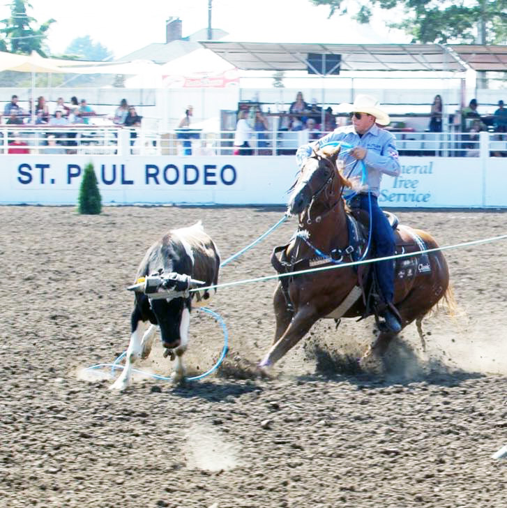 Paden Bray roping at the St. Paul Rodeo in 2019. Paden and his partner, Erich Rogers, came in first place for Aggregate Team Roping.