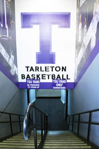 The Tarleton Basketball sign hangs over the stairway to enter the basketball court in Wisdom Gym.
