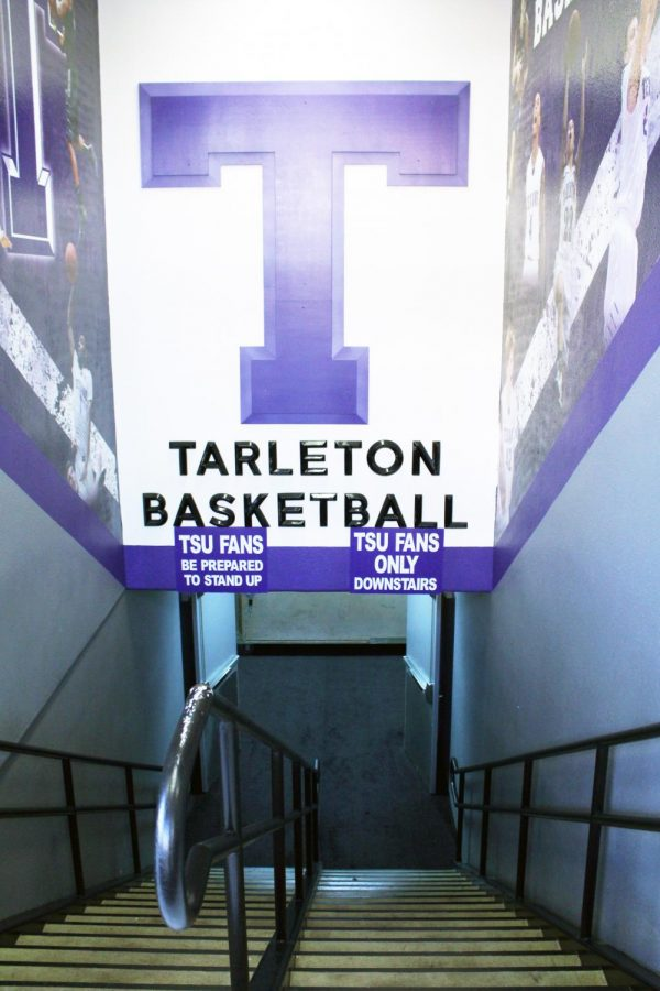 The+Tarleton+Basketball+sign+hangs+over+the+stairway+to+enter+the+basketball+court+in+Wisdom+Gym.