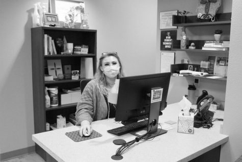 Admin Associate, Shelby Gilson, at the Tarleton Student Counseling Services check in desk ready to help with any student needs.