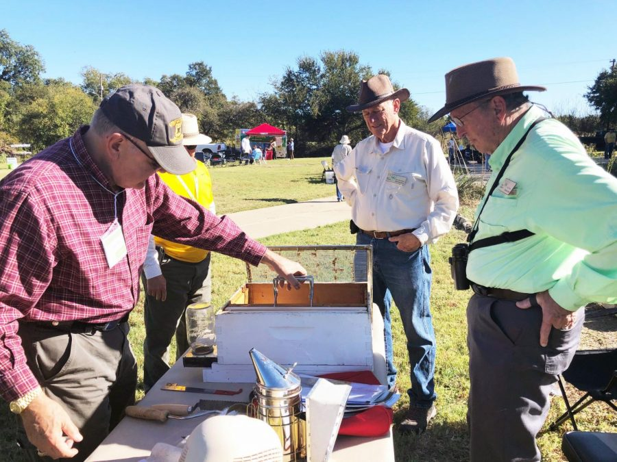 Lloyd Lietz speaks about beekeeping to Edd Robinett, Bob McCormick, and Bob Wood at The Prairie Oaks Master Naturalists Nature Fest in 2019.