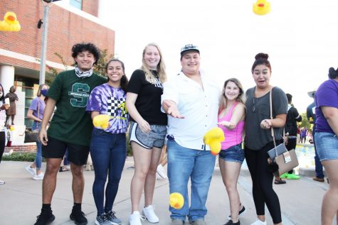 Yoseline Hernandez, Jessica Vaden, Justin Montalbo, Hailey Campbell and Zugelly Idaly Espinosa launching their ducks into the Nursing Building reflecting pool on Oct. 13, 2020 during TSU Spirit week.