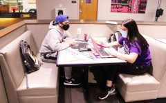 Jonathan Hernandez and Presley Riddell studying in the Dick Smith Library.