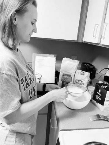 Kiley Kocian sifting flour to make Gammie's fluffy flapjacks.