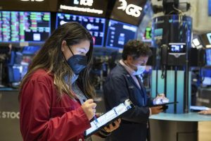 In this photo provided by the New York Stock Exchange, trader Ashley Lara works on the floor, Friday, Jan. 29, 2021. GameStops stock is back to the races Friday, and the overall U.S. market is down again, as the saga thats captivated and confused Wall Street ramps up the drama.