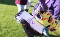 Members of The Purple Poo took to signing many autographs during the Purple Poo 100 year celebration concert.
