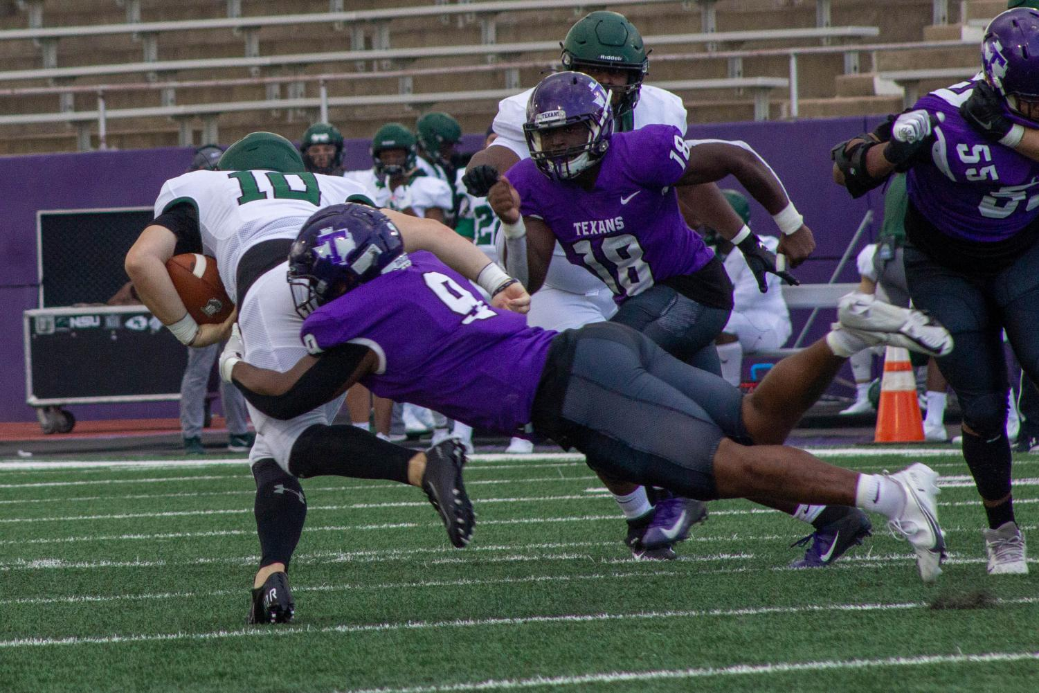 ChadWick Thibodeaux tackling an opponent during the Northeastern state football game on March 27, 2021.