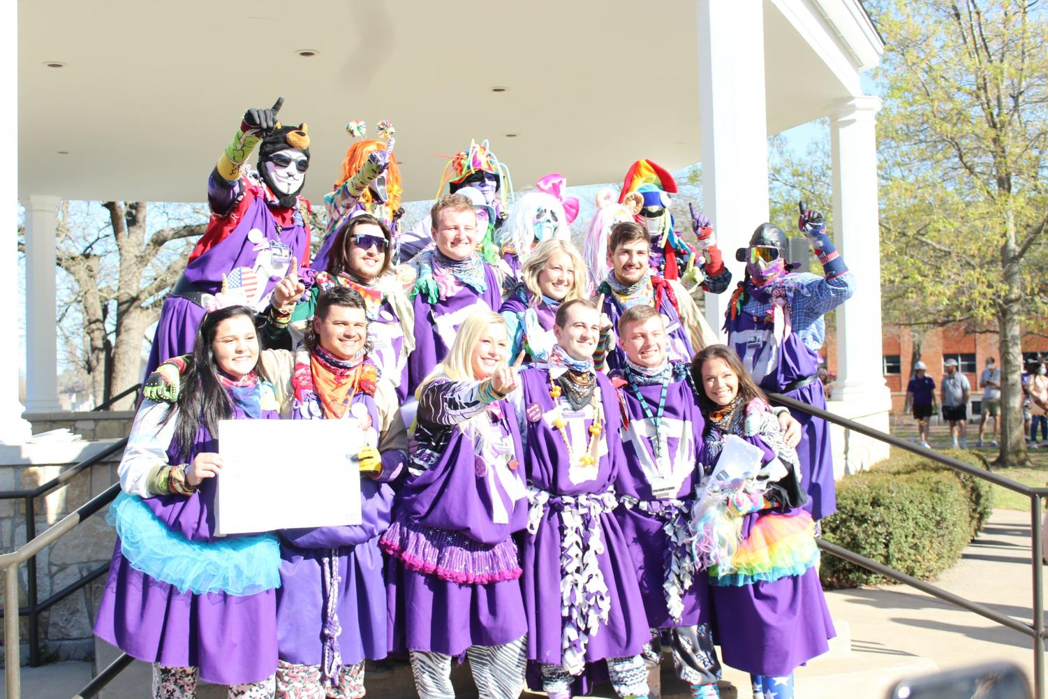 Members of the Purple Poo at the unmasking ceremony on March 26, 2021.