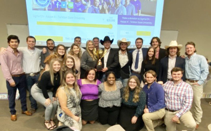 Members of Delta Phi Epsilon after winning the Sigma Chi Derby Days competition by helping collect $25,000 in donations. All donations were made to the Huntsman Cancer Institute.