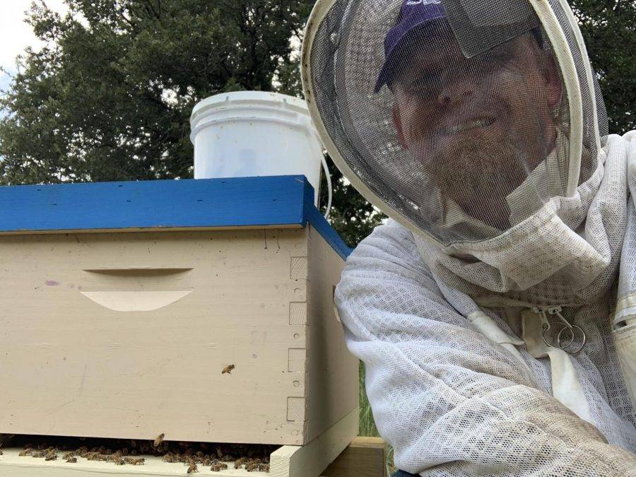 Patrick+Kostecka+and+one+of+over+40+hives+he+maintains.+This+one+is+a+Langstroth+hive%2C+one+of+the+most+commonly+used.