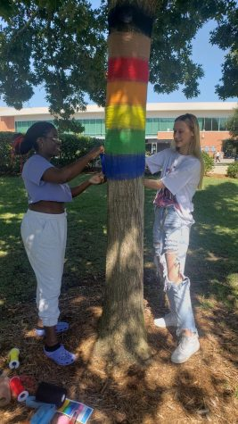 ODIIP Students rewrap trees that were vandalized