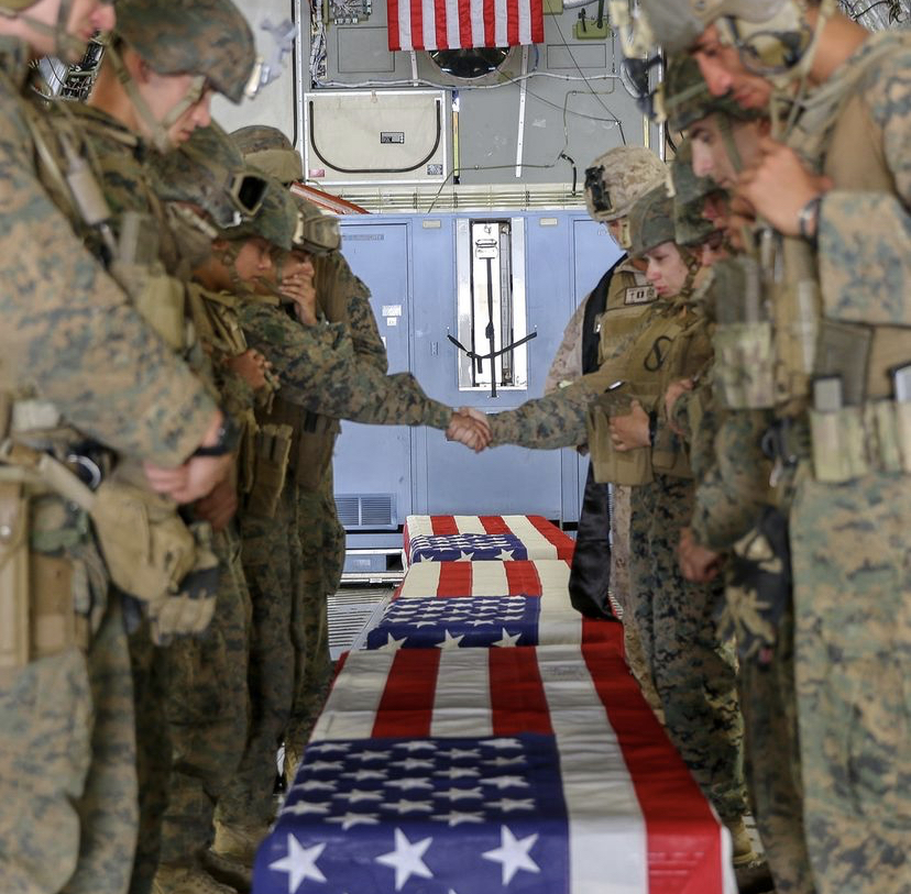 U.S. Marines honoring their fallen during a Ramp Ceremony at Hamid Karzai International Airport.
